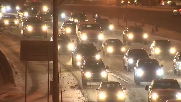 Traffic is piling up on Calgary roads as drivers make their way in to work during a major snowstorm on December 2, 2013.
