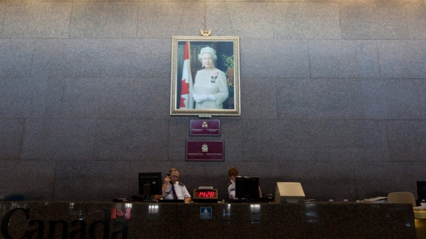 A portrait of the Queen hangs on the Sovereign's Wall at the entrance to the Department of Foreign Affairs building in Ottawa, Tuesday, July 26, 2011. (Adrian Wyld / THE CANADIAN PRESS)