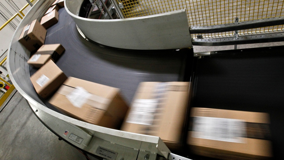 In this Monday, Nov. 26, 2012, file photo. packages are ready to ship move along a conveyor belt at the Amazon.com 1.2 million square foot fulfillment center, in Phoenix. (AP / Ross D. Franklin)
