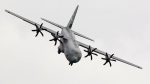 FILE - An Hercules C-130 performs during its exhibition flight at the 48th Paris Air Show. (AP / Jacques Brinon)