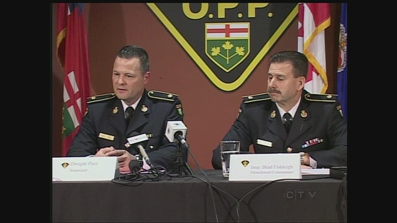 OPP Insp. Dwight Peer, left, and OPP Insp. Brad Fishleigh speak at a press conference in London, Ont. on Monday, Dec. 2, 2013. (Cristina Howorun / CTV London)