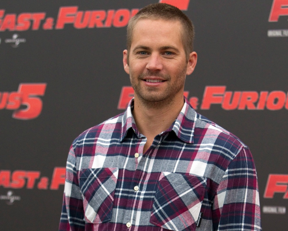 """Actor Paul Walker poses during a photo call for """"Fast & Furious 5"""" in Rome, April 29, 2011. (AP / Andrew Medichini)"""