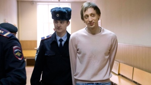 Pavel Dmitrichenko, right, is escorted to a court room in Moscow, Russia, Tuesday, Dec. 3, 2013. (AP / Alexander Zemlianichenko)