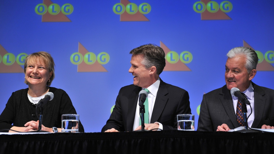 OLG's President and CEO Rod Phillips (centre) and Mike Hamel, OLG's Director of Corporate Investigations, announce Kathryn Jones of Hamilton as the identified winner of the the outstanding $50 million LOTTO MAX jackpot from the November 30, 2012 draw. (OLG Handout photo)