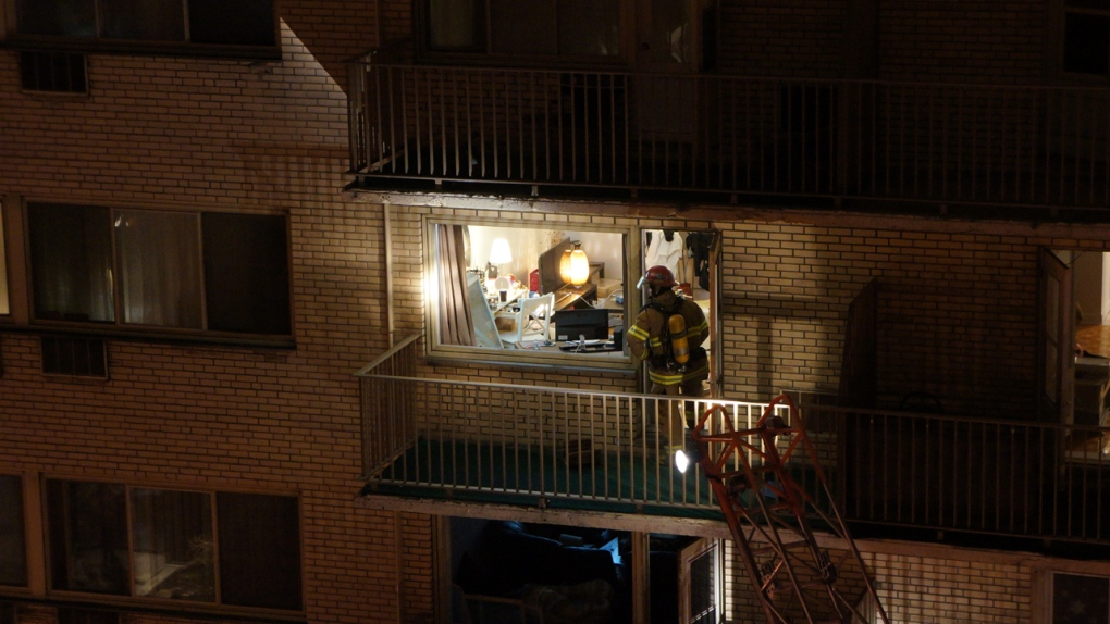 A firefighter inspects an apartment after a fire o