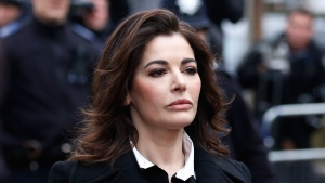 Celebrity chef, Nigella Lawson, arrives at Isleworth Crown Court in London, Wednesday, Dec. 4, 2013. (AP / Sang Tan)