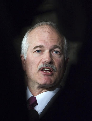 NDP Leader Jack Layton talks to reporters outside the House of Commons in Ottawa on Monday. (CP / Fred Chartrand)