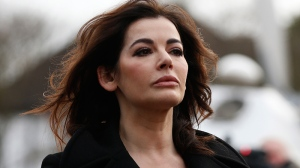 Celebrity chef Nigella Lawson arrives at Isleworth Crown Court in London, Thursday, Dec. 5, 2013. (AP Photo/Sang Tan)