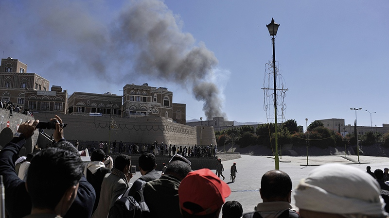 Smoke rises after an explosion at the Defence Ministry complex in Sanaa, Yemen, Thursday, Dec. 5, 2013. (AP / Mohammed Hamoud)