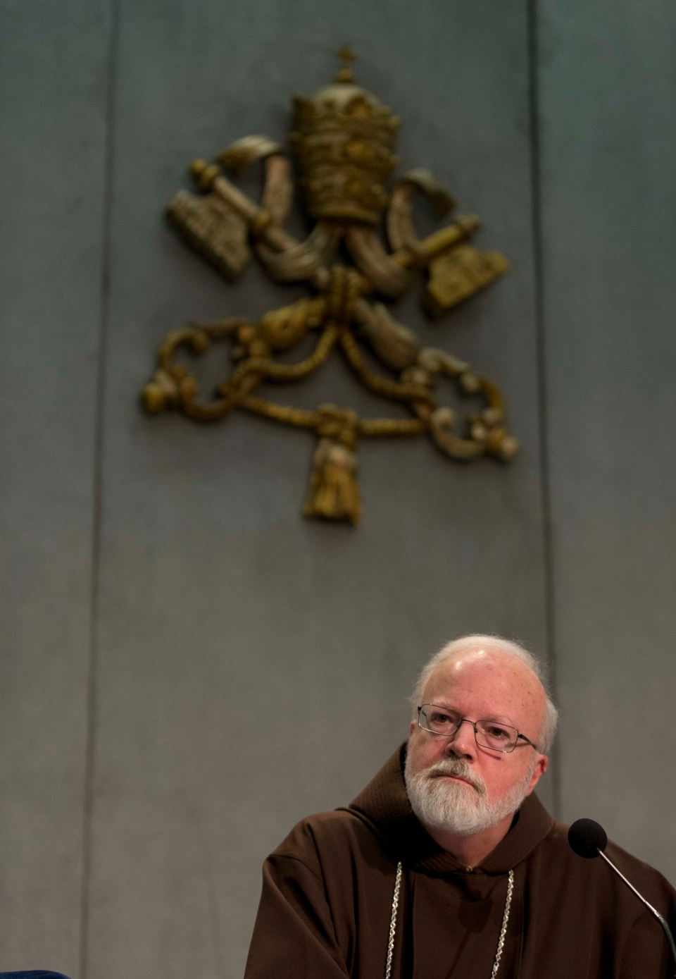 Cardinal Sean O'Malley, the archbishop of Boston, listens to a reporter's questions during a press conference at the Vatican, Thursday, Dec. 5, 2013. (AP Photo/Alessandra Tarantino)