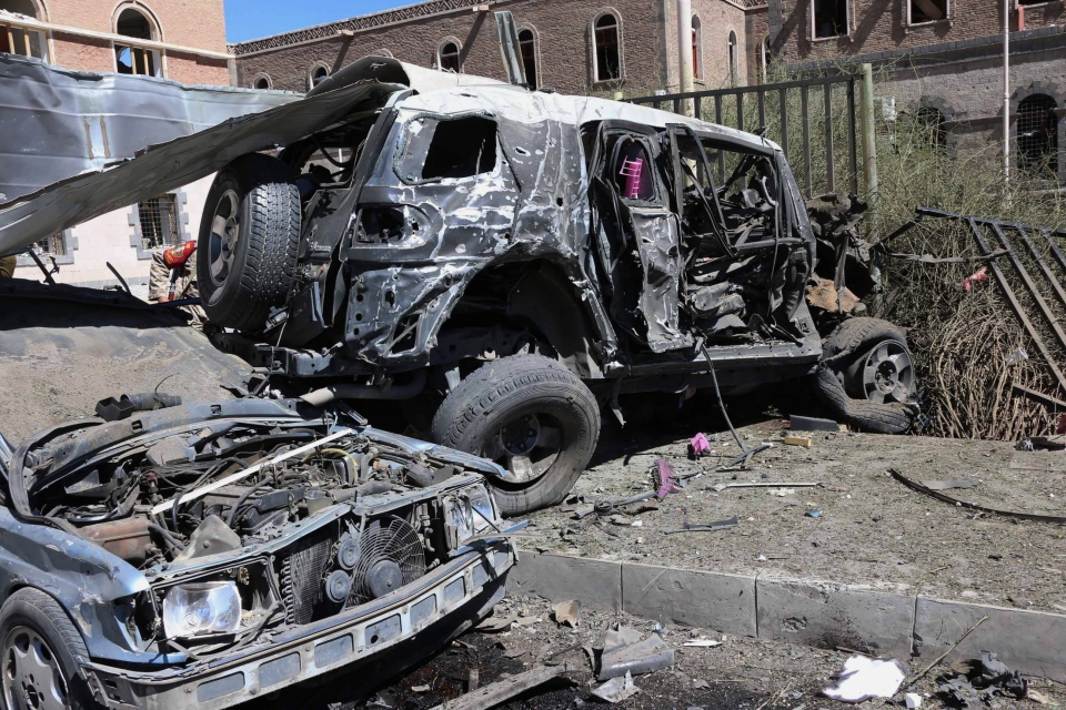This photo provided by Yemen's Defense Ministry shows damaged vehicles after an explosion at the Defense Ministry complex in Sanaa, Yemen, Thursday, Dec. 5, 2013. (AP / Yemen's Defense Ministry)