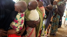 Somali women carrying their malnourished children in a refugee camp for internally displaced people in Mogadishu, Somalia, Thursday, July 28 2011. (AP / Farah Abdi Warsameh)