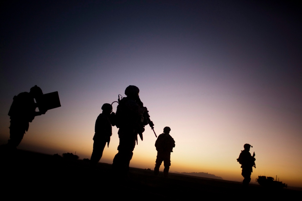 Soldiers patrol the outskirts of Spin Boldak, near the Afghanistan border with Pakistan, in 2009. (AP / Emilio Morenatti)