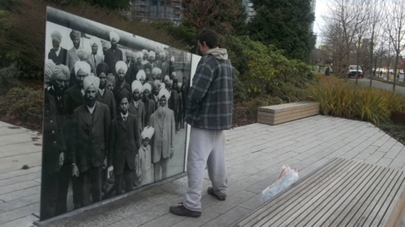 A man allegedly urinates on the Komagata Maru memorial in Vancouver's Coal Harbour on Dec. 2. (CTV)
