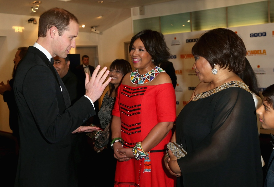 Britain's Prince William, Duke of Cambridge, meets Zindzi Mandela, right, the daughter of former South African President, Nelson Mandela, as they attend the Royal Film Performance of Mandela: Long Walk to Freedom, at the Odeon Leicester Square, London. (AP / Chris Jackson)