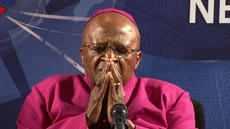 In this frame made from video, retired Anglican Archbishop Desmond Tutu holds his hands together at a press conference in Cape Town, South Africa, Friday, Dec. 6, 2013, following the death of Nelson Mandela Thursday. (AP / SABC via APTN)