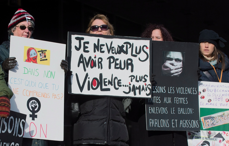Four women attend a demonstration in Montreal, Friday, December 6, 2013, to highlight violence against women. (Graham Hughes / THE CANADIAN PRESS)