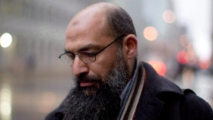 Mohamed Mahjoub stands outside a federal court in Toronto on Dec. 15, 2011. (Chris Young / THE CANADIAN PRESS)