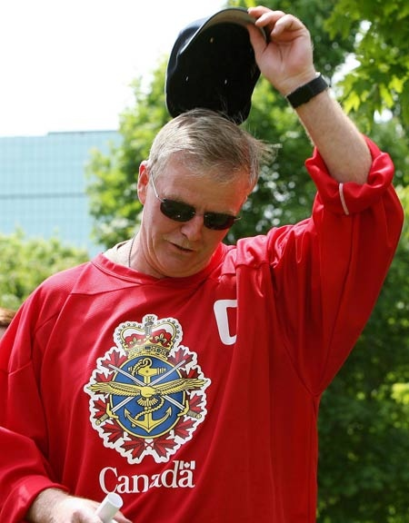General Rick Hillier, Chief of the Defence Staff, tips his hat as he is applauded by military and civilian staff during Canada Forces Day in Ottawa on Friday, May 30, 2008. (THE CANADIAN PRESS / Sean Kilpatrick)