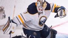 Buffalo Sabres goalie Jhonas Enroth (1) sweeps the