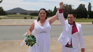 Same sex couple Stacey Cowan, right, and Corrina Peck celebrate after taking their wedding vows at Old Parliament House in Canberra, Australia, Saturday, Dec. 7, 2013. (AP / Rob Griffith)