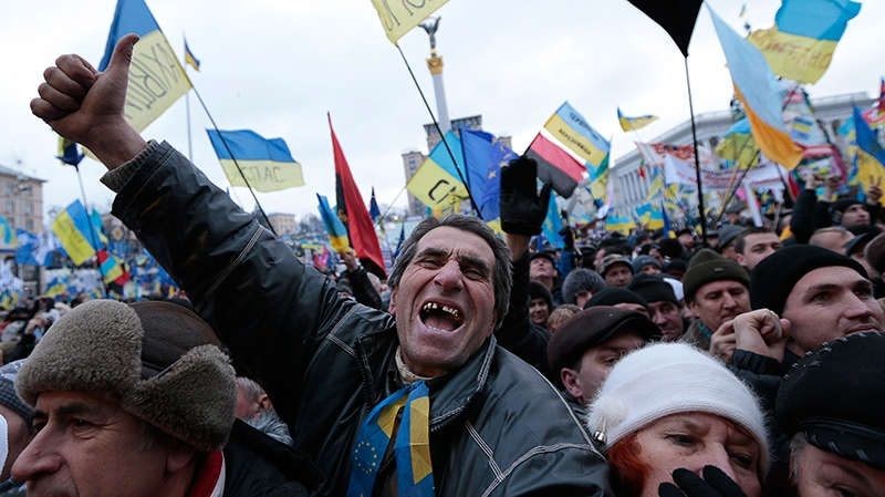 Pro-European Union activists shout slogans during a rally in the Independence Square in Kyiv, Ukraine, Sunday, Dec. 8, 2013. (AP / Ivan Sekretarev)