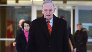 Former prime minister Jean Chretien prepares to board a flight for South Africa to attend a memorial for Nelson Mandela, in Ottawa, Sunday, Dec.8, 2013. (Adrian Wyld / THE CANADIAN PRESS)