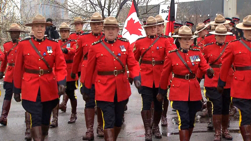Officers march in a procession for Toronto Const. John Zivcic, Monday, Dec. 9, 2013.