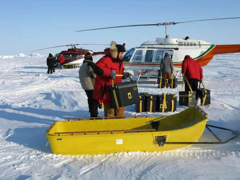 Canadian Geological Survey hydrographer Mike Black loads seismic instruments onto a sled prior to their being deployed on the sea ice 155 kilometres north of Ellesmere Island on April 2, 2008. (The Canadian Press/HO-Ron Verrall)