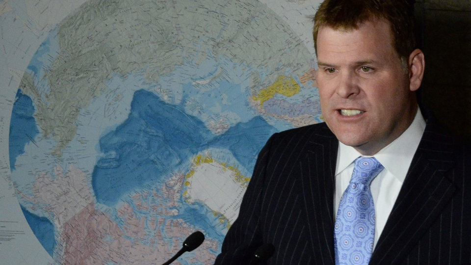 Foreign Affairs Minister John Baird speaks in front of a map of the Arctic in Ottawa, Monday, Dec.9, 2013. (Sean Kilpatrick / THE CANADIAN PRESS)
