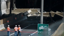 Emergency crews survey the scene after a section of an overpass collapsed in downtown Montreal, Sunday, July 31, 2011.THE CANADIAN PRESS/Graham Hughes