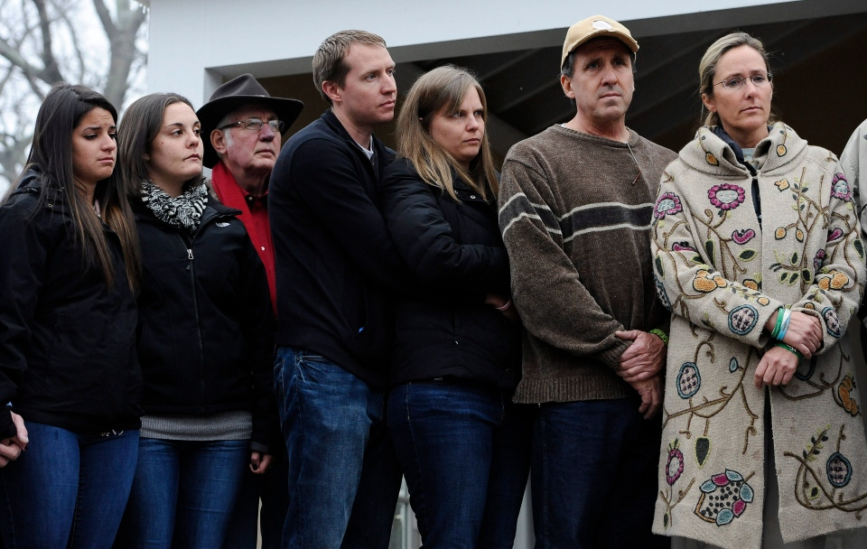 From the left, Carlee Soto, sister of Sandy Hook Elementary School shooting victim Victoria Soto, Erica Lafferty and George Hochsprung, daughter and husband of victim Dawn Hochsprung, Robbie and Alyssa Parker, parents of Emilie Parker, and Neil Heslin and Scarlett Lewis, parents of Jesse Lewis, stand with other family members as they address media, in Newtown, Conn., Monday, Dec. 9, 2013.  (AP / Jessica Hill)