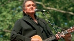 In this May 23, 1993, file photo, Johnny Cash performs at a benefit concert in Central Park in New York. (AP Photo/Joe Tabacca, File)