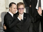 In this file photo, Elton John, right, and his longtime partner David Furnish embrace at the Guildhall in the town of Windsor, England, Wednesday, Dec. 21, 2005. (AP / Lefteris Pitarakis)