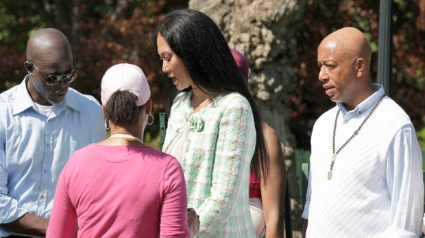 Kimora Lee Simmons, center, and her ex-husband, hip-hop producer Russell Simmons, right, attend the Easter Egg Roll on April 25, 2011, at the White House in Washington. The pair came together in the name of charity at a dinner gala that supports arts programs for inner-city kids.(AP Photo/J. Scott Applewhite)