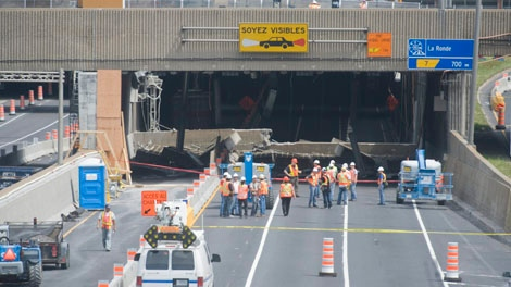Emergency crews survey the scene after a scetion of an overpass collapsed in Montreal Sunday, July 31, 2011.THE CANADIAN PRESS/Graham Hughes