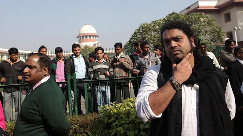Indian gay rights activists and others stand outside the Supreme Court after the top court ruled that a colonial-era law criminalizing homosexuality will remain in effect in India in New Delhi, India, Wednesday, Dec. 11, 2013. (AP / Tsering Topgyal)