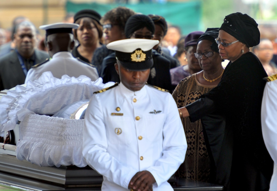 Nelson Mandela's widow Graca Machel, right, pays her respects to former South African President Nelson Mandela during the lying in state at the Union Buildings in Pretoria, South Africa, Wednesday, Dec. 11, 2013. (Elmond Jiyane / GCIS)