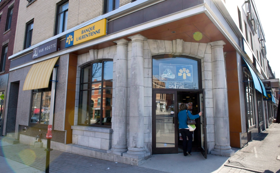 In this March 20, 2012 file photo, a patron enters a Laurentian Bank in Montreal. (Paul Chiasson / THE CANADIAN PRESS)