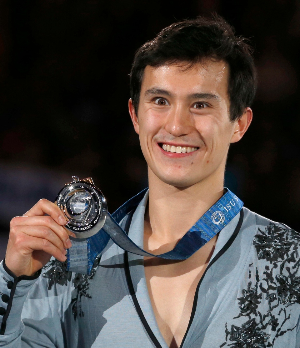 Patrick Chan of Canada poses for photographers after the awarding ceremony of the men's event of the ISU Grand Prix Final figure skating in Fukuoka, western Japan, Friday, Dec. 6, 2013. (AP Photo/Shizuo Kambayashi)