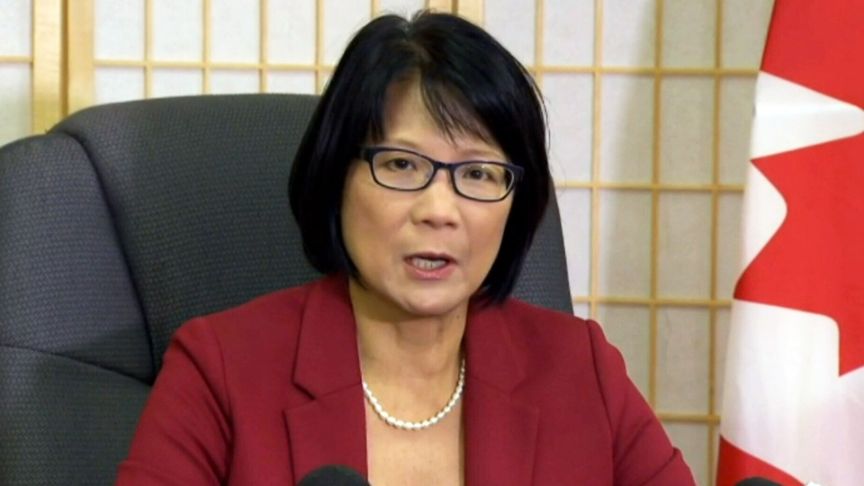 Federal Transport Critic Olivia Chow reacts to the news of the Canada Post phase out on Wednesday, Dec. 11, 2013.