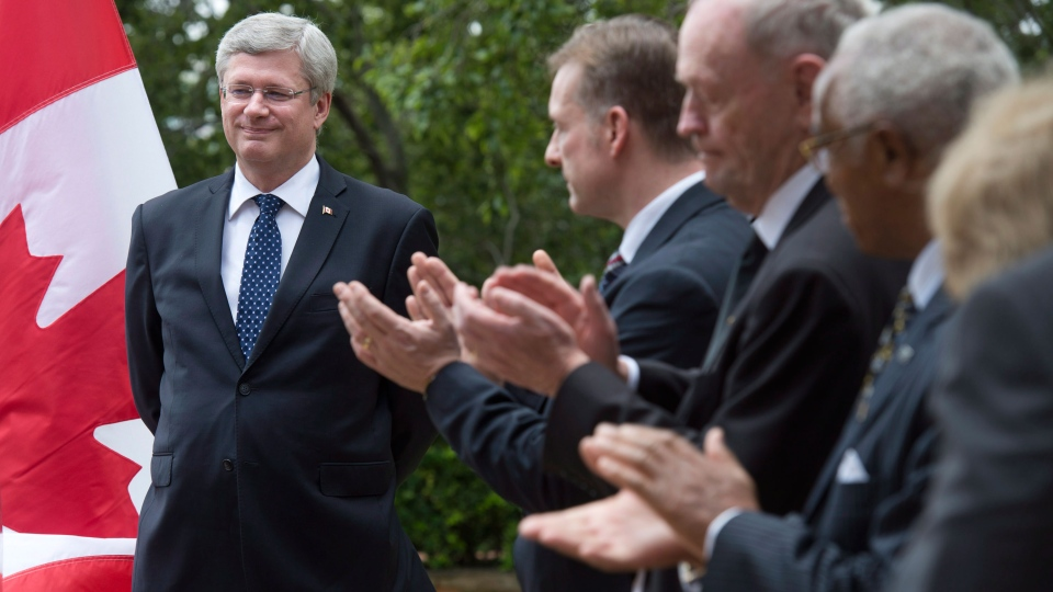 Prime Minister Stephen Harper is applauded as he is introduced for an announcement in Pretoria, South Africa, Wednesday, Dec. 11, 2013. (Adrian Wyld / THE CANADIAN PRESS)