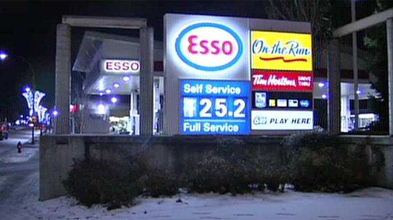 An Esso station at King George Boulevard and 104 Avenue was the scene of a suspected carjacking, and may be connected to a seemingly random stabbing that occurred earlier in the night. Dec. 12, 2013. (CTV)