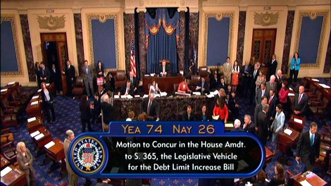 The U.S. Senate approves emergency bill to avert a first-ever government default with just hours to spare on Capitol Hill in Washington, Tuesday, Aug. 2, 2011.