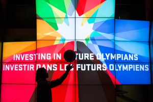 Shay Colley, a member of the Canada Women's Junior basketball team, practices her skills in from of a screen following an announcement by the Canadian Olympic Committee (COC) in Toronto on Thursday December 12, 2013. (Chris Young / THE CANADIAN PRESS)