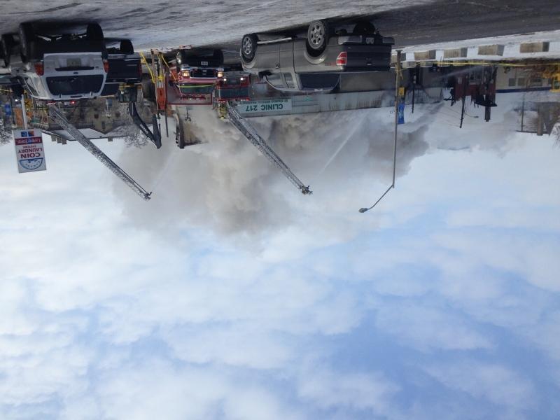Firefighters battle a blaze in St. Thomas, Ont. on Thursday, Dec. 12, 2013.