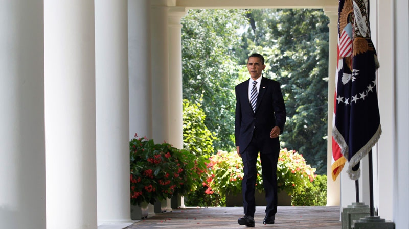 President Barack Obama walks to the Rose Garden of the White House in Washington, Tuesday, Aug. 2, 2011, after the Senate passed the debt ceiling legislation. (AP / Carolyn Kaster)