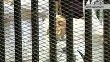 This video image taken from Egyptian State Television shows 83-year-old Hosni Mubarak laying on a hospital bed inside a cage of mesh and iron bars in a Cairo courtroom on Wednesday Aug. 3, 2011. (AP Photo/Egyptian State TV)