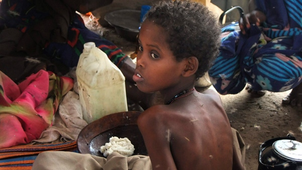 A child from southern Somalia takes food at a camp in Mogadishu, Somalia, Wednesday, Aug 3, 2011. (AP / Farah Abdi Warsameh)
