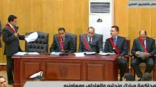 State prosecutors work during the trial of former Egyptian President Hosni Mubarak in a Cairo courtroom, Wednesday, Aug. 3, 2011. (Egyptian State TV)